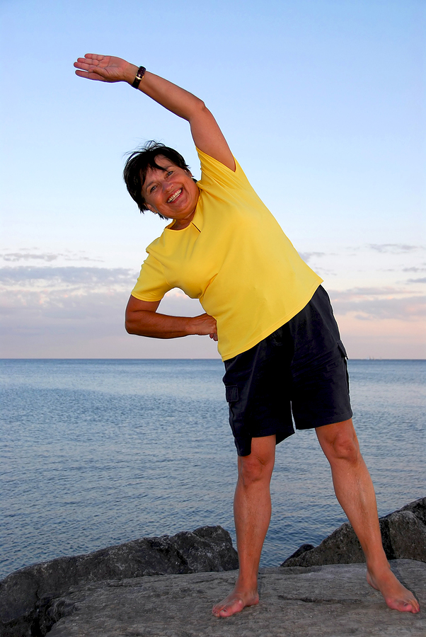 Woman exercising in front of beach